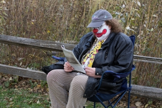 Douglas Bean plays The Clown and reads the paper while waiting for the shot to be set up