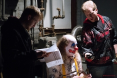Director Joe Goudreault going over notes while Douglas Bean (plays The Clown) gets metered for lighting